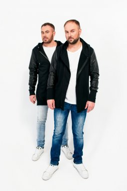 Portrait of two men in black jackets