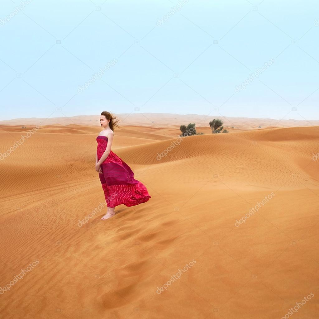 beautiful young girl in desert in Dubai