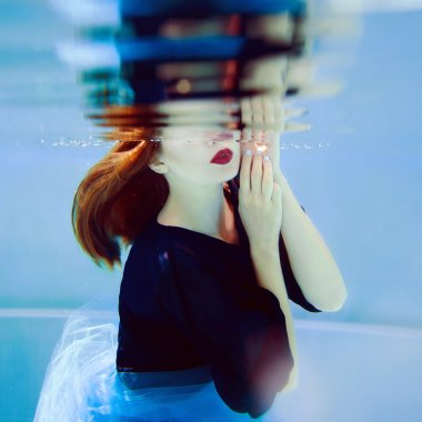 stylish woman underwater in the swimming pool