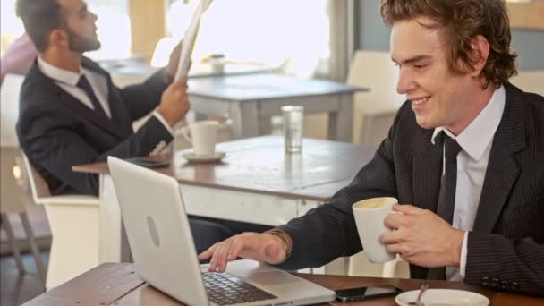 business man drinking coffee and working in cafe