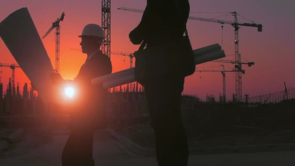 Two men working near new construction