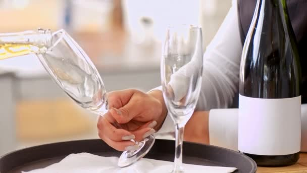 Staff waiter holding glasses