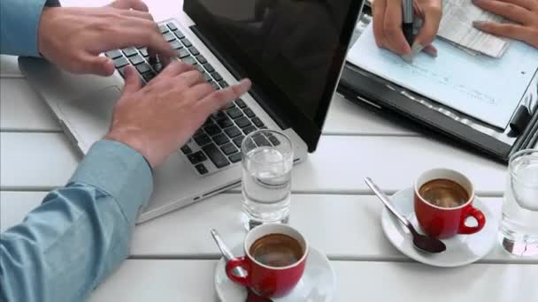 business people working with laptop and drinking coffee