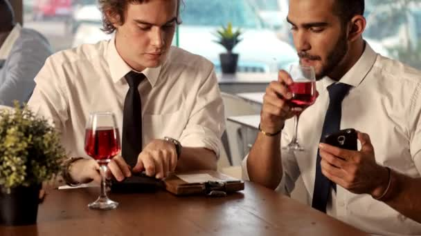 Waiter in a restaurant brings bill to table