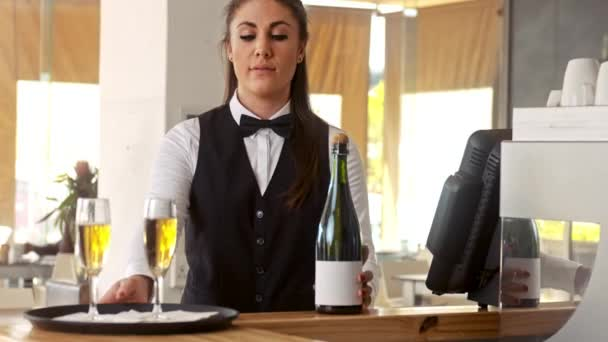 waiter holding tray with champagne glasses