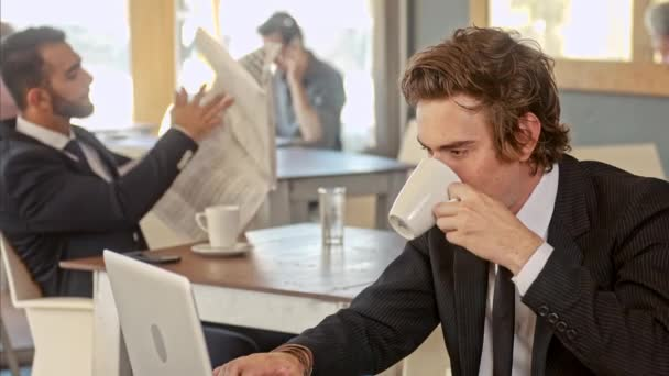 business man thinking wile drinking his coffee in cafe