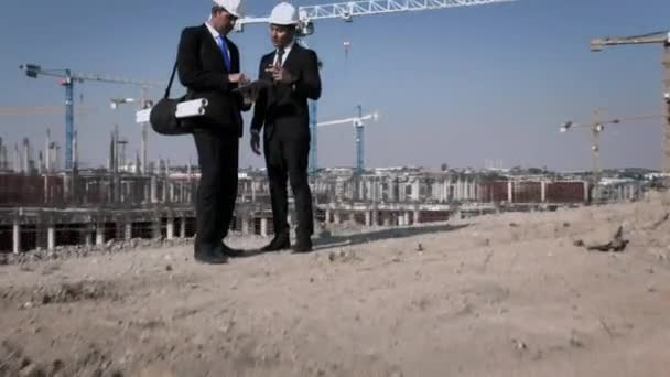architect and engineer discussing near construction