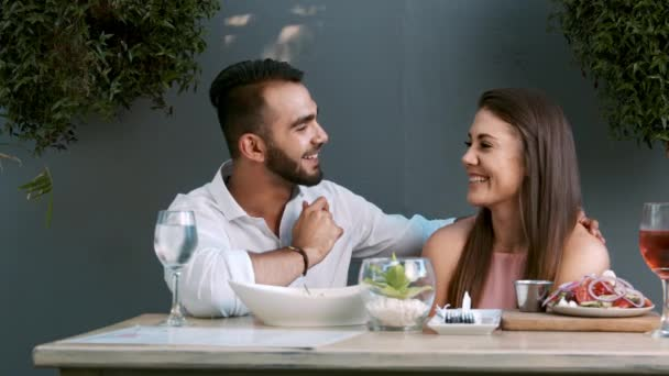 couple having dinner on date in cafe