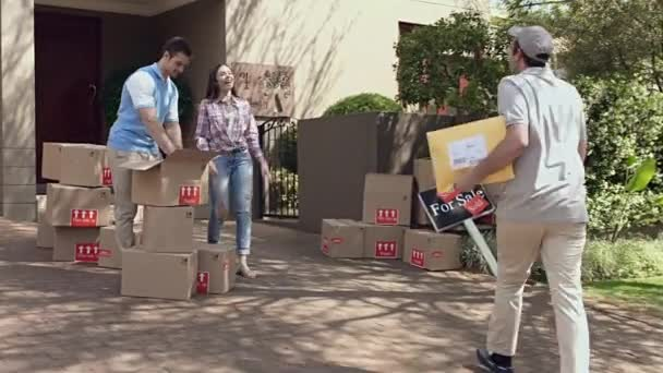 Delivery man delivering package to a couple