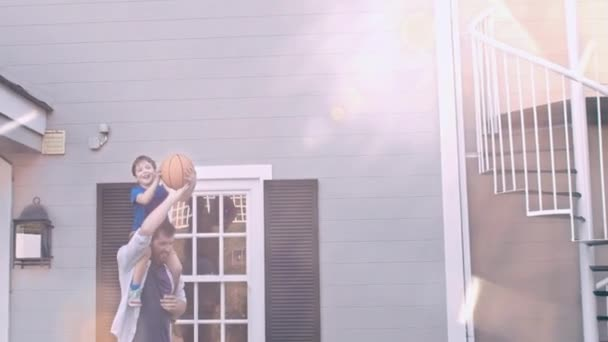 father and son dunking the basketball in hoop