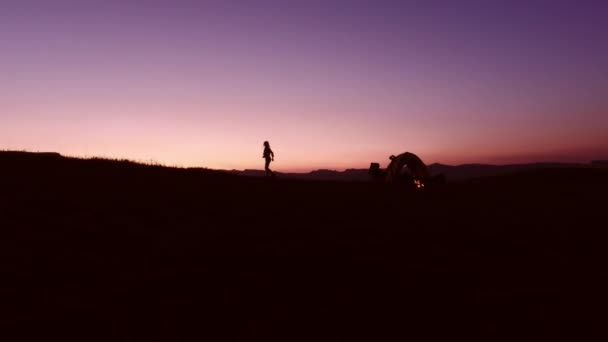 female camper enjoying sunset