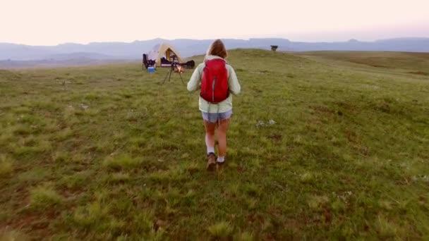 woman traveler walking towards camp