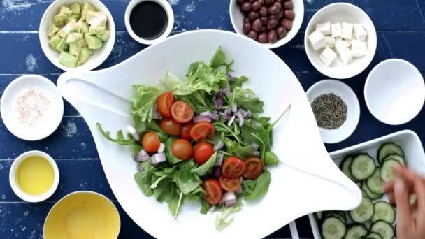 preparing and making a Greek salad