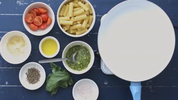 making basil pesto pasta