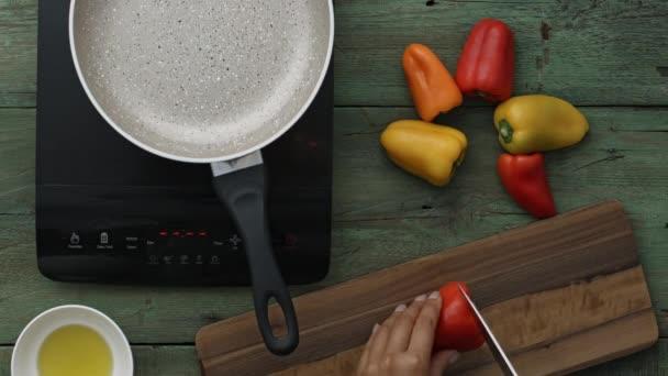 hands preparing roasted peppers