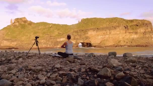 Woman practicing yoga for video blog