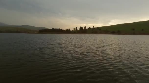 lake and mountain landscape at sunset.