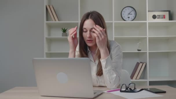 Confused young caucasian woman reading email on computer, feeling depressed of getting bad news online, professional exam failure, receiving dismissal notice, lost job concept.