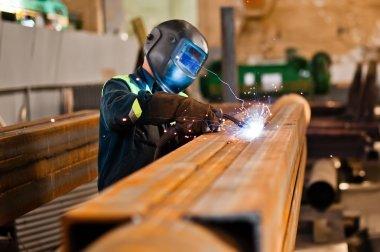 Welder welding steel.