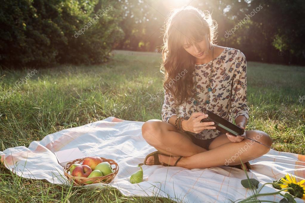 Girl in park listening old radio