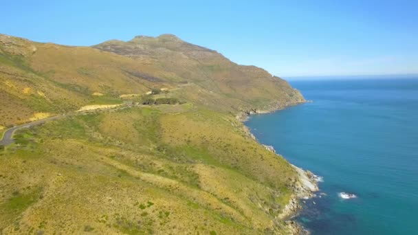 Chapmans Peak Drive 4K UHD aerial footage of mountain cliff coastline. Cape Town South Africa. Part 3 of 4