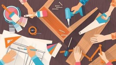 Team of workers using DIY tools