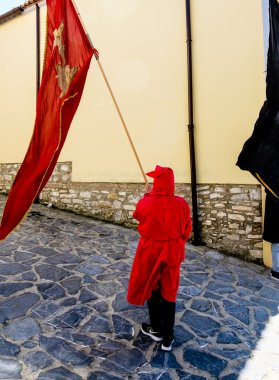 Red  hooded man with red flag