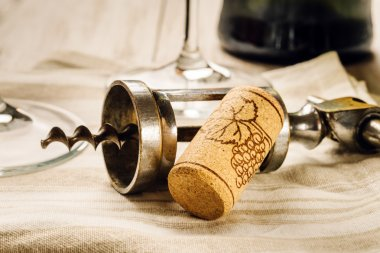 corkscrew, cork and glasses
