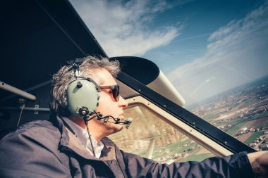 Pilot of ultralight aircraft in flight stock vector