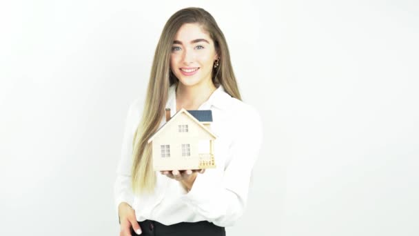 Young woman holding a house in her hands. Isolated on white. architecture, building, construction, real estate and property concept