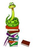 Fotografia Serpente sveglio del fumetto con la pila di libro