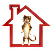 cute Tiger cartoon character with home sign  and sunglass