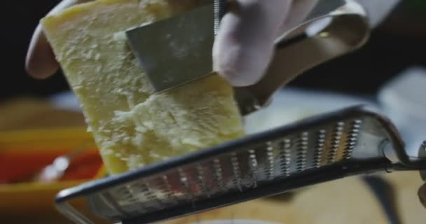 Chef grating Parmesan cheese on a special dish in Italian cuisine