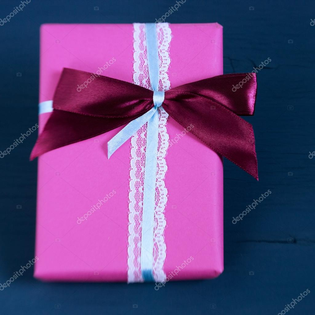 Packed box, gift on a wooden light-blue background. Selective focus ...