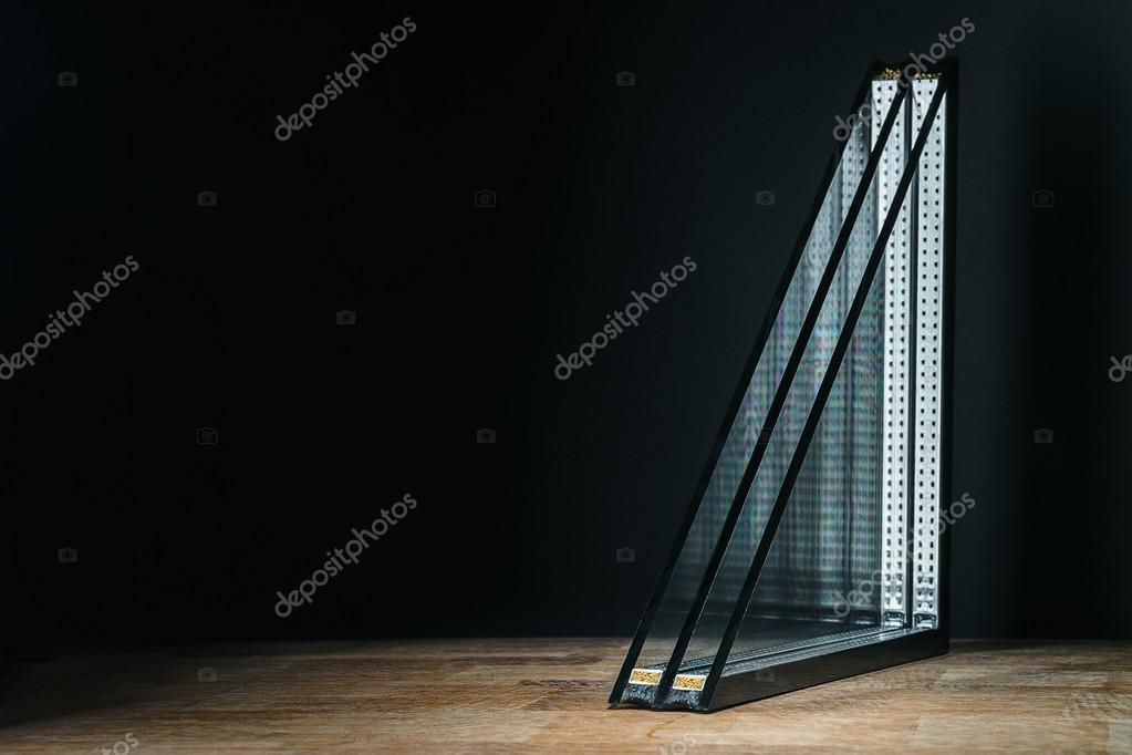 triple glazing, wooden base, black background, place for text