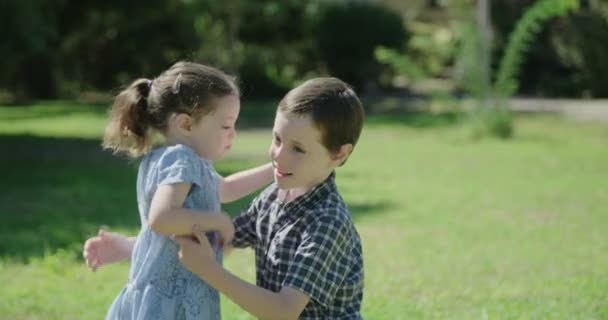 A brother and his little sister hugging and kissing