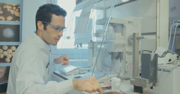 TEL AVIV, ISRAEL, APRIL 2016: Pharmacist working at pharma company