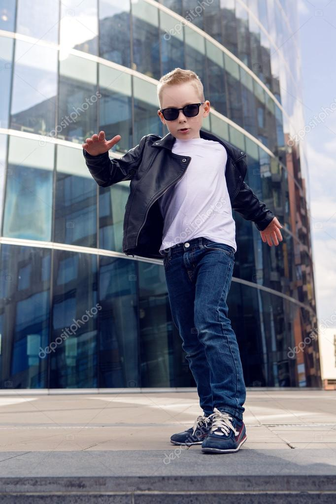 dfb5492eb089 baby boy 7 - 8 years in a black leather jacket dancing — Stock Photo ...