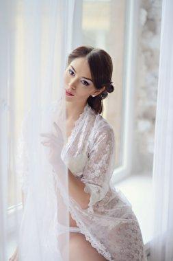 Beautiful woman in white negligee