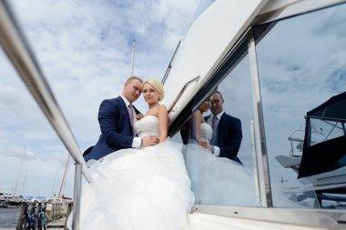 Wedding couple hugging on yacht