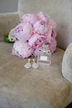 Beautiful bouquet and perfume bottle