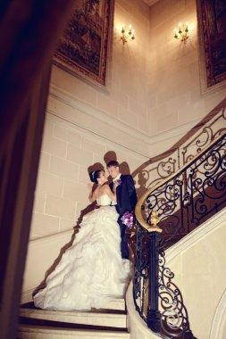 Wedding couple hugging on stairs