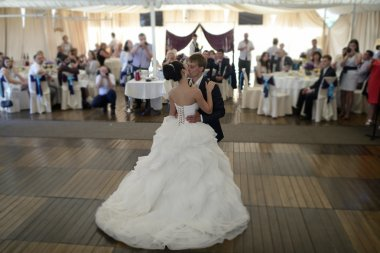 Wedding couple dancing in restaurant