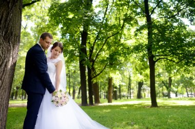 Beautiful bride and groom in park