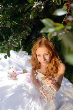 Beauty bride with bouquet on nature