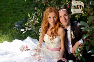 Beauty bride with groom in nature