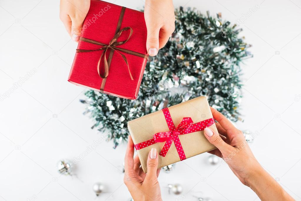 Closeup of hands giving gifts to each other stock photo closeup of hands giving gifts to each other stock photo 124153744 negle Choice Image