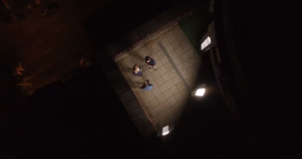Young guys on the roof of building in center of city at night