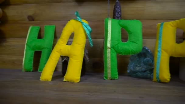 Happy Day from felt letters on fireplace