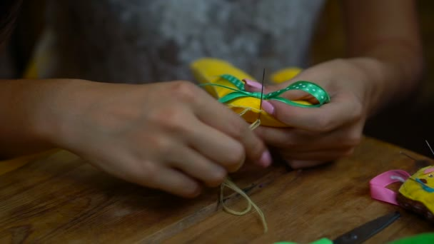 Handmade girls sewing letters of felt